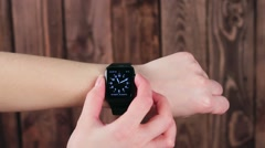 Girl Demonstrates the Functions of Smart Watches in His Hand. Modern Technology Stock Footage