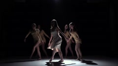 Start contemporary dance of five girls in white dresses, on black, shadow, slow Stock Footage