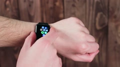 Man Demonstrates the Features of Smart Watches in His Hand. Modern - stock footage