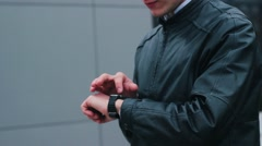 Stylish Man Using Smart Watch Standing Near the Office. Stock Footage
