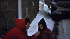 1961: Mother bundling Ralphie for winter snow play like Christmas story movie. - stock footage