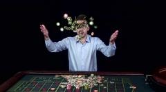 Man smiles hugely as tosses winnings in the air. Black Stock Footage