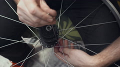 Mechanic repairing wheel in workshop. Close up Stock Footage