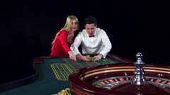 Couple playing roulette wins at the casino. Black Stock Footage