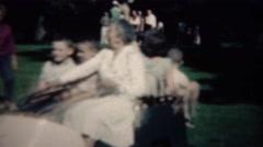 1961: Grandma driving happy kids in golf around retirement home. Stock Footage