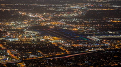 Night Airport Cityscape Time Lapse with Zoom Burbank and Los Angeles Stock Footage