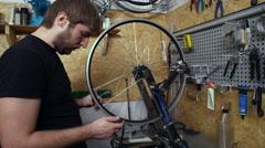 Mechanic repairing wheel in workshop. Close up Stock Footage