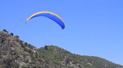 Paraglider flying close to camera on sunny, summer day at the Oludeniz Beach Stock Footage