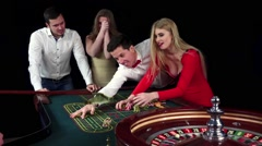 Couple celebrating win at roulette table. Black Stock Footage
