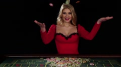 Casion lady throwing chips in the air. Black Stock Footage