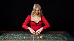 Girl puts bets in the casino club and lose everything, black, slow motion Stock Footage