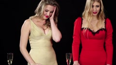 Girls drink champagne playing roulette. Black - stock footage