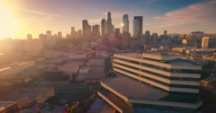 Aerial view city Los Angeles downtown skyline sunset Camera flying forward 4K - stock footage