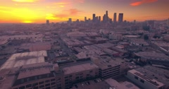 Aerial view Los Angeles downtown skyline at sunset Camera flying backward 4K UHD - stock footage
