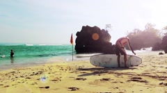 Surfer on the shore.Padang Padang Beach,Bali Stock Footage