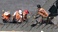 Builders pour cement to a concrete wall Stock Footage