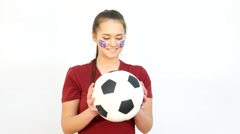Winking Soccer British Fan Catching Ball - stock footage