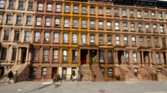 New York City street buildings driving moving tracking dolly in Harlem Stock Footage
