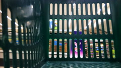 Time Lapse of empty supermarket shopping cart basket - stock footage