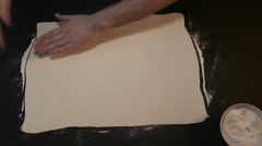 Cuts a Piece of Raw Dough Into Two Parts Stock Footage