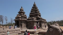 Ancient temple of Mahabalipuram view from Outside with People walking Stock Footage