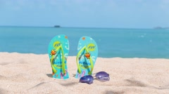 Woman on a tropical beach. FlipFlop background. Beautiful girl goes to the sea Stock Footage