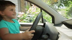 Little boy at the wheel in the car Stock Footage
