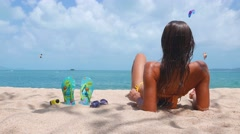 Woman on a tropical beach. FlipFlop background - stock footage
