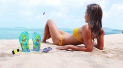 Woman on a tropical beach. FlipFlop background Stock Footage