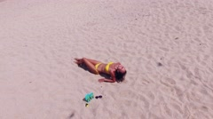 Woman on a tropical beach. FlipFlop background. Aerial view Stock Footage
