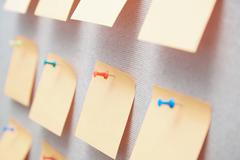 Sticky notes on a bulletin board Stock Photos