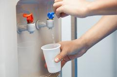 Drinking purified water - stock photo