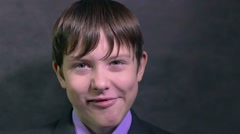 Boy teen businessman makes faces faces emotions mug slow motion Stock Footage