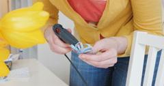 Woman using glue pistol Stock Footage