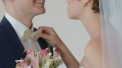 Bride and groom kiss each other - stock footage