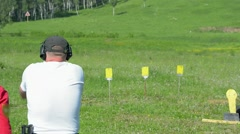 Stock Video Footage of Man shoot with a gun in targets on shooting range.