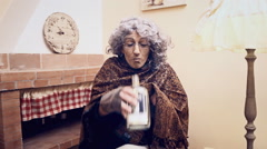 Grotesque granny secret drink - stock footage