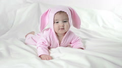 Baby in bunny costume on a white background Stock Footage