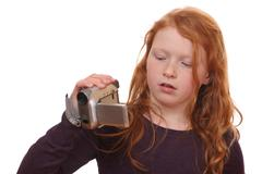 Girl with camcorder Stock Photos