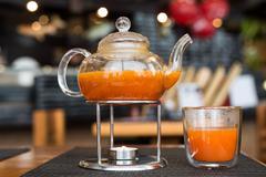 Sea Buckthorn tea candle basking in  Japanese restaurant - stock photo