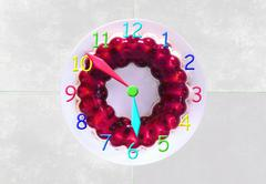 Clock made of a gelly cake showing 6 o'clock - stock photo