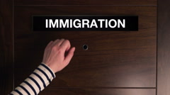 Female hand knocking at immigration service door Stock Footage