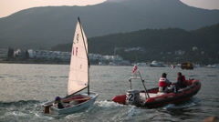 Sailboats training in harbour near hong kong at sunset Stock Footage