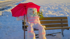 The chilling snowman on the bench - stock footage