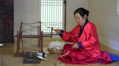 Hand-spinning fibers in the Korean Folk Village. Seoul, South Korea Stock Footage