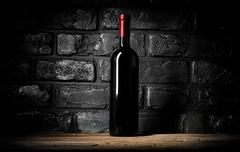 Wine and wall of bricks - stock photo