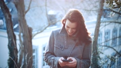 Attractive Businesswoman with mobile phone outdoors Stock Footage
