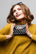 Girl in a bright dress with clutch bag polka dots Stock Photos