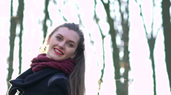 Pretty happy caucasian girl smiling into the camera, sunny day Stock Footage