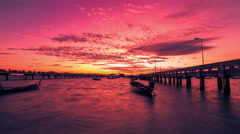 4K TimeLapse. Boats on the pier Chalong during a red dawn sunrise in Phuket Stock Footage